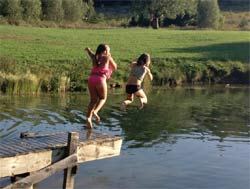Kids jumping into the water